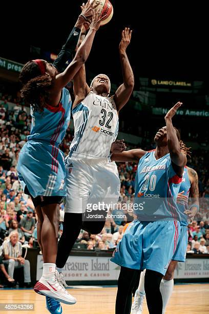 Rebekkah Brunson of the Minnesota Lynx shoots against Aneika Henry of the Atlanta Dream during the WNBA game on July 22 2014 at Target Center in...