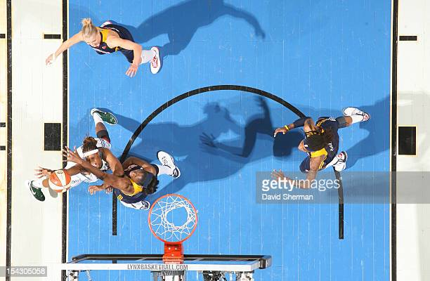 Rebekkah Brunson of the Minnesota Lynx shoots the ball against Jessica Davenport of the Indiana Fever during the 2012 WNBA Finals Game Two on October...