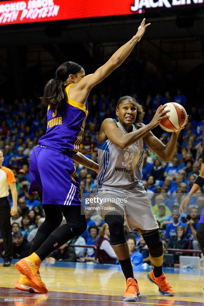 Rebekkah Brunson #32 of the Minnesota Lynx shoots the ball against Candace Parker #3 of the Los Angeles Sparks during the first quarter of Game Two of the WNBA Finals on September 26, 2017 at Williams in Minneapolis, Minnesota. The Lynx defeated the Sparks 70-68.
