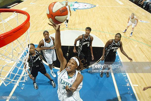 Rebekkah Brunson of the Minnesota Lynx shoots the ball against the San Antonio Silver Stars during the game on July 8 2010 at the Target Center in...