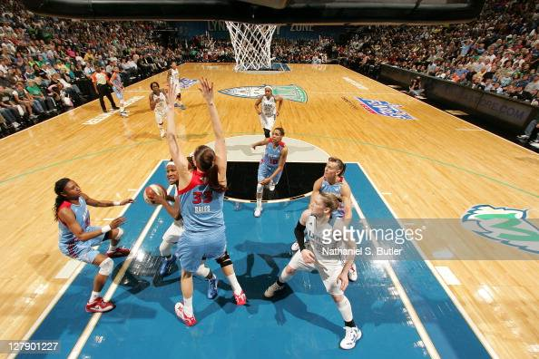 Rebekkah Brunson of the Minnesota Lynx takes the ball to the basket under pressure against Alison Bales of the Atlanta Dream in Game One of the 2011...