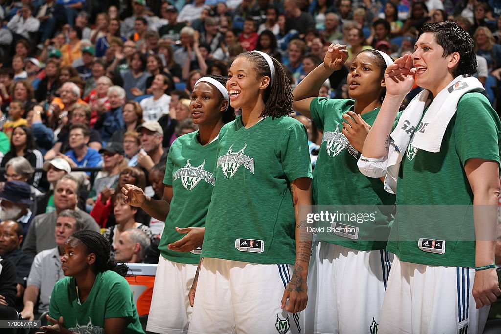 Rebekkah Brunson #32, Seimone Augustus #33, Maya Moore #23, and Janel McCarville #4 of the Minnesota Lynx celebrate during the WNBA game against the Phoenix Mercury on June 6, 2013 at Target Center in Minneapolis, Minnesota.