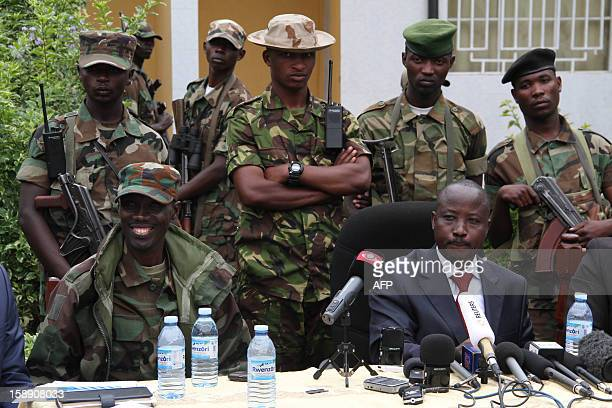 M23 rebel Commander Brigadier General Sultani Makenga and the groups president Bishop JeanMarie Runiga give a press conference at Bunagana on 3...