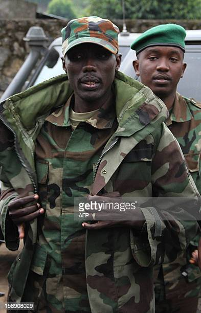 M23 rebel Commander Brigadier General Sultani Makenga arrives for a press conference at Bunagana on January 3 2013 The M23 rebel group wants the...