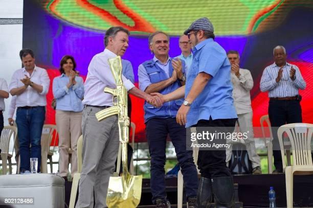 FARC rebel commanderinchief leader Rodrigo Londono Colombian President Juan Manuel Santos and the UN SecretaryGeneral's Special Representative for...