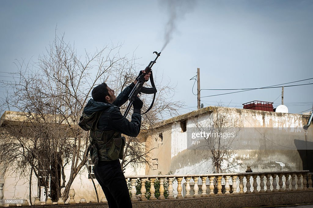 A Rebel fighter fires at a government jet fighter in the city of Aleppo on January 18, 2013. UN leader Ban Ki-moon warned that Syria is in a 'death spiral', as his top humanitarian and human rights officials pleaded with the UN Security Council to take firmer action.