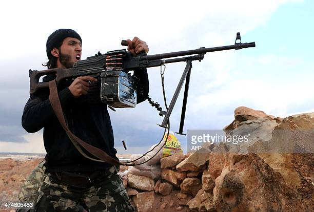 A rebel fighter fires towards proregime forces during clashes in Sheikh Najar area of the restive Syrian city of Aleppo on February 25 2014 Syrian...