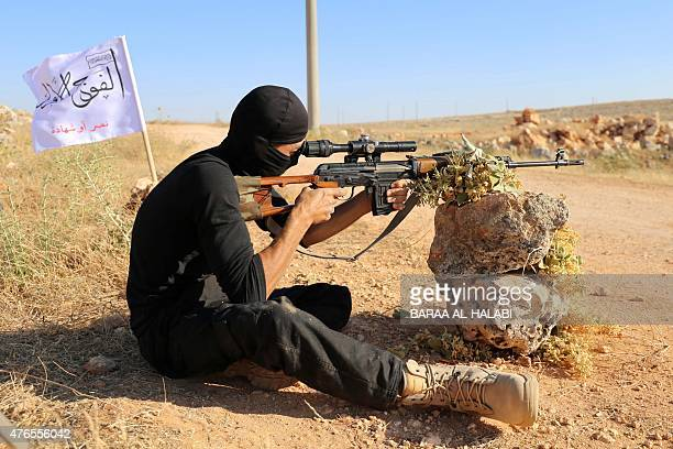 A rebel fighter from the 'First Battalion' under the Free Syrian Army takes part in a military training on June 10 in the rebelheld countryside of...