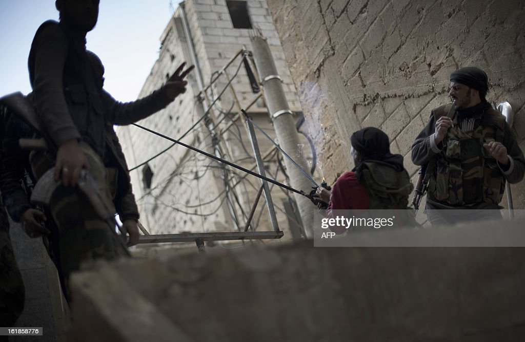 A rebel fighter launches a pipe bomb from a homemade slingshot into a building supposedly housing pro-government troops on February 16, 2013, in Deir Ezzor, in eastern Syria. UN-Arab League peace envoy Lakhdar Brahimi urged international backing for a Syrian opposition offer to begin talks with the regime, which he proposed be held in United Nations offices.