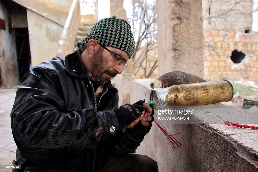 A rebel fighter prepares improvised explosive devices during the battle against pro-government forces for control of the Handarat region, located just north of Aleppo, on December 18, 2014. Handarat has been divided since a rebel offensive in summer 2012 between loyalist sectors in the west of the city and insurgent-held territory in the east.