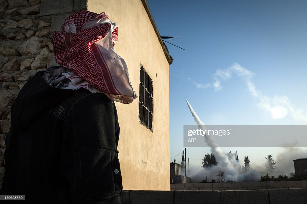 A Rebel fighter watches a rocket launch in the city of Aleppo on January 17, 2013. UN leader Ban Ki-moon warned that Syria is in a 'death spiral', as his top humanitarian and human rights officials pleaded with the UN Security Council to take firmer action.