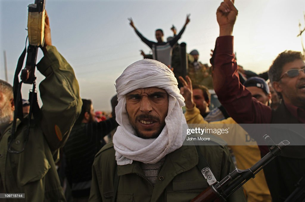 Rebel fighters advance on the front line against Libyan government forces on March 2, 2011 in al-Brega, Libya. The rebels drove out troops loyal to President Muammar Gaddafi from the coastal town after the government forces had taken it overnight.