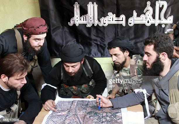 Rebel fighters from the 'AlMujahedin The Falcons of Islam' brigade looks at a map as they prepare an operation to 'liberate' an area controlled by...