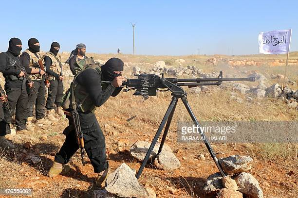 Rebel fighters from the 'First Battalion' under the Free Syrian Army take part in a military training on June 10 in the rebelheld countryside of the...