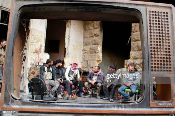 Rebel fighters gather ahead clashes with proregime forces in the northern city of Aleppo on November 6 2013 The Syrian conflict has killed more than...