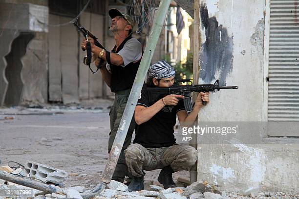 Rebel fighters hold a position on a front line in the Damascus suburb of Yalda on September 18 2013 in Syria AFP PHOTO WARD ALKESWANI