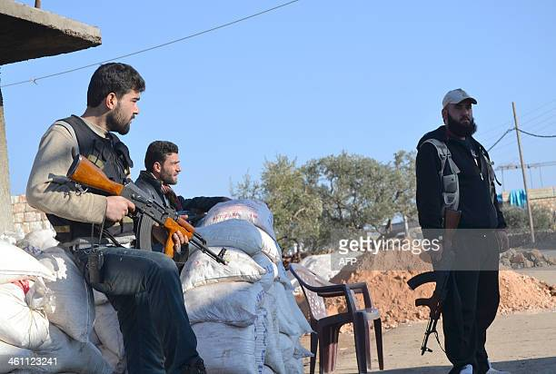 Rebel fighters man a checkpoint close to Jabal alZawiyaa in Idlib province on January 6 2014 A UNhosted peace conference on Syria must work to remove...
