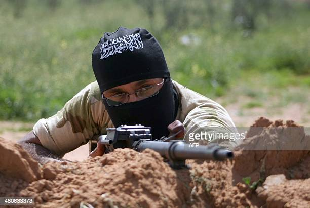 Rebel fighters members of the alSham Brigade take part in a training session in the northeastern city of Deir Ezzor on March 25 2014 Syria's...