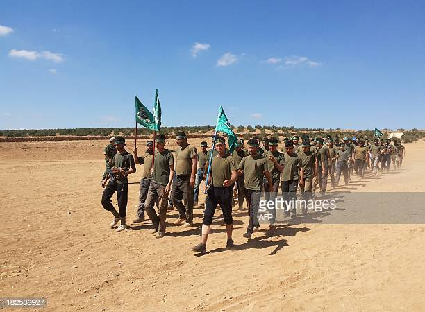 Rebel fighters of the Yarmuk Brigade march as they train on the outskirts of the southern Syrian city of Daraa on September 29 2013 The opposition...