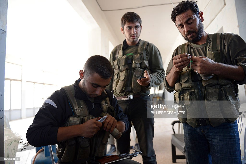 Rebel fighters prepare homemade hand grenades during fighting against pro-Syrian government troops in the Bustan al-Bashar district of the northern Syrian city of Aleppo, on October 27, 2012. Syrian rebels clashed with Kurdish militia in the northern city of Aleppo, leaving 30 dead and around 200 captured, a watchdog said, sparking fears of a new front in an already fractured country.
