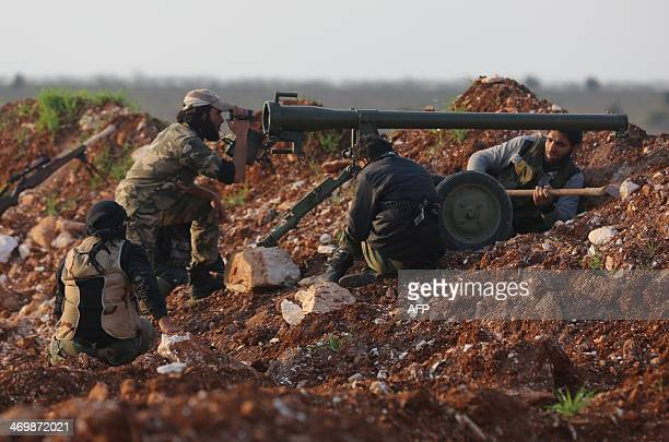 Rebel fighters prepare to fire an antitank cannon towards the government forces AlSamman checkpoint on a road leading to Idlib near the Syrian city...