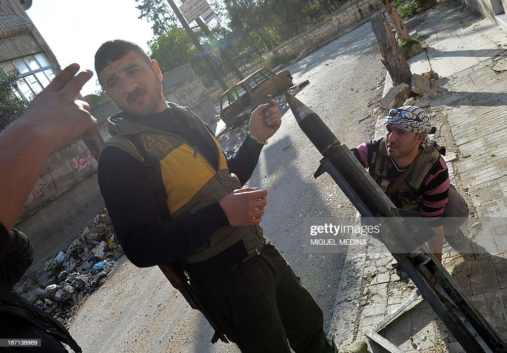 Rebel fighters prepare to launch of a rocket in the Saif al-Dawla district of the northern Syrian city of Aleppo, on April 21, 2013. Syria's National Coalition head Ahmad Moaz al-Khatib has refiled his resignation and an interim leader is being sought, a fellow member and a source close to the main opposition group said. AFP PHOTO/MIGUEL MEDINA