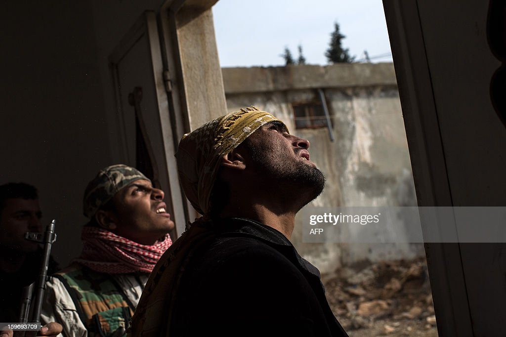 Rebel fighters try to locate a government jet fighter in the city of Aleppo on January 18, 2013. UN leader Ban Ki-moon warned that Syria is in a 'death spiral', as his top humanitarian and human rights officials pleaded with the UN Security Council to take firmer action.
