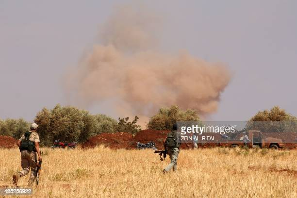 Rebel forces from Jaysh alIslam take position behind a sand barrier on August 25 2015 on the frontline in the Bashkoy area on the northern outskirts...