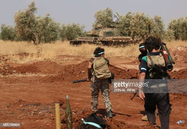 Rebel forces from Jaysh alIslam take position on August 25 2015 on the frontline in the Bashkoy area on the northern outskirts of Aleppo where...