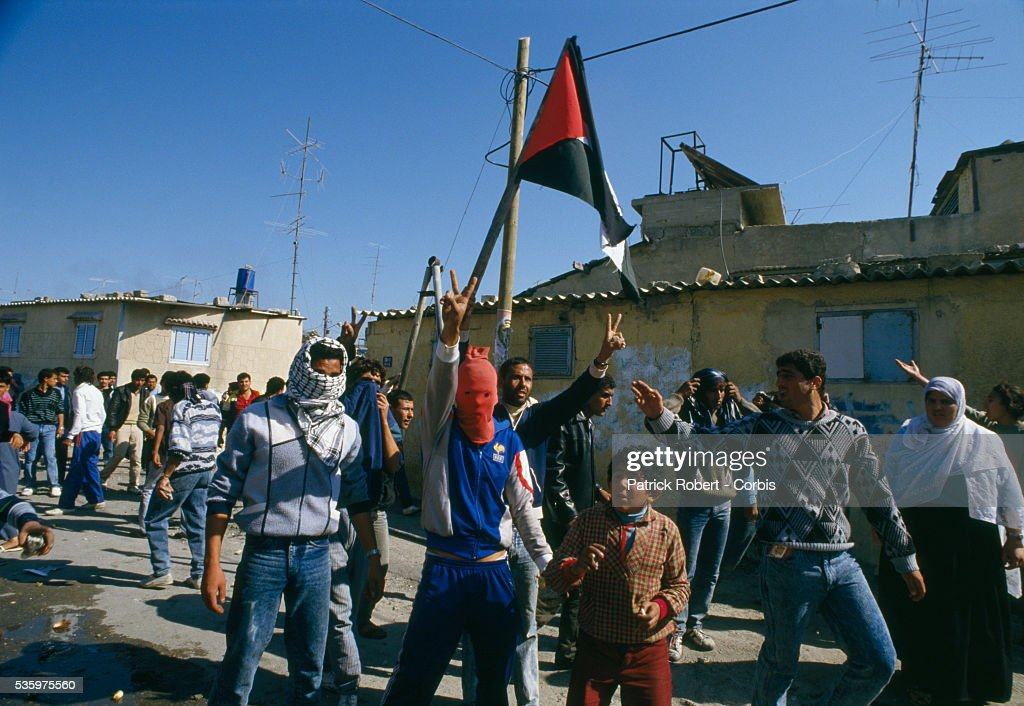 Rebel Israeli and Palestinian fighters protest in the occupied territory of Gaza during the first Intifada. The Israeli administrative custody camp was closed and declared a military zone after violence broke out.