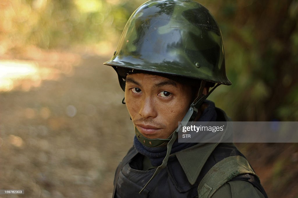 A rebel Kachin Independence Army (KIA) 3rd Brigade soldier stands guard as they secure an area on Hka Ya mountain in Kachin province on January 20, 2013. Kachin ethnic minority rebels in war-torn northern Myanmar accused the military of launching a fresh attack on January 20, just days after a ceasefire pledge by the country's reformist government.