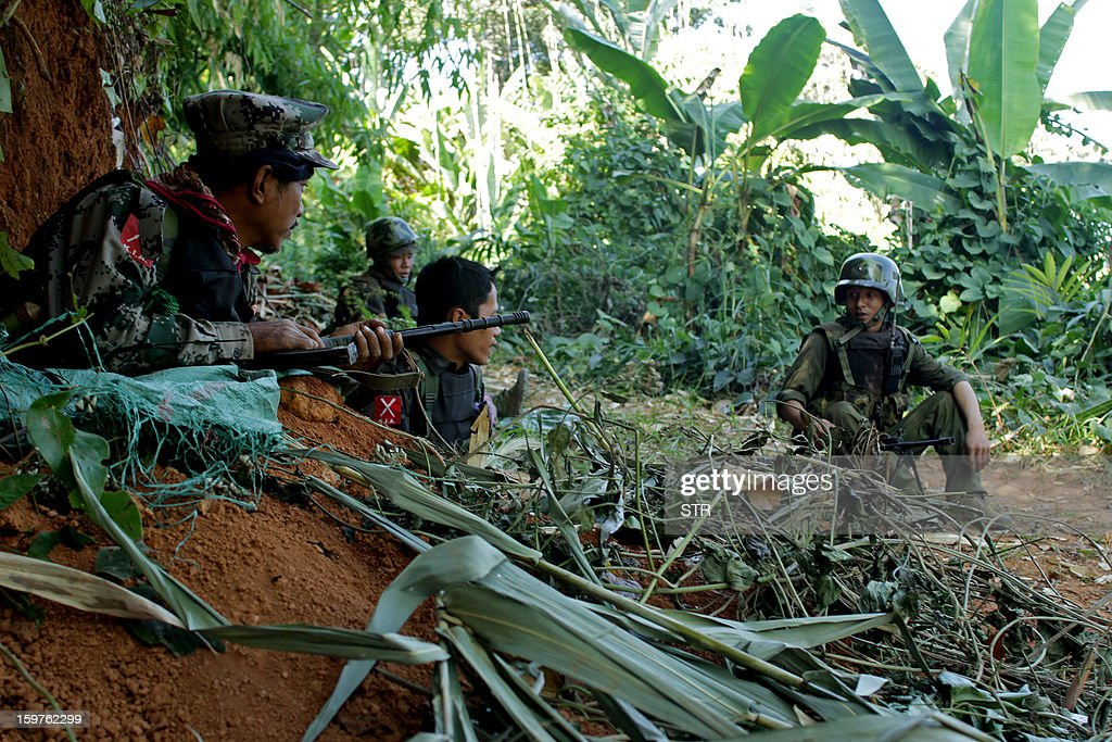 Rebel Kachin Independence Army (KIA) 3rd Brigade soldiers secure an area on Hka Ya mountain in Kachin province on January 20, 2013. Kachin ethnic minority rebels in war-torn northern Myanmar accused the military of launching a fresh attack on January 20, just days after a ceasefire pledge by the country's reformist government.