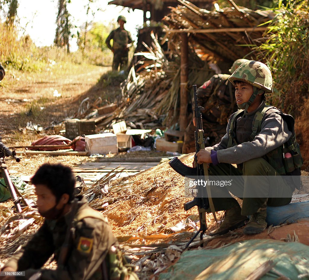 Rebel Kachin Independence Army (KIA) 3rd Brigade soldiers stand guard as they secure an area on Hka Ya mountain in Kachin province on January 20, 2013. Kachin ethnic minority rebels in war-torn northern Myanmar accused the military of launching a fresh attack on January 20, just days after a ceasefire pledge by the country's reformist government.