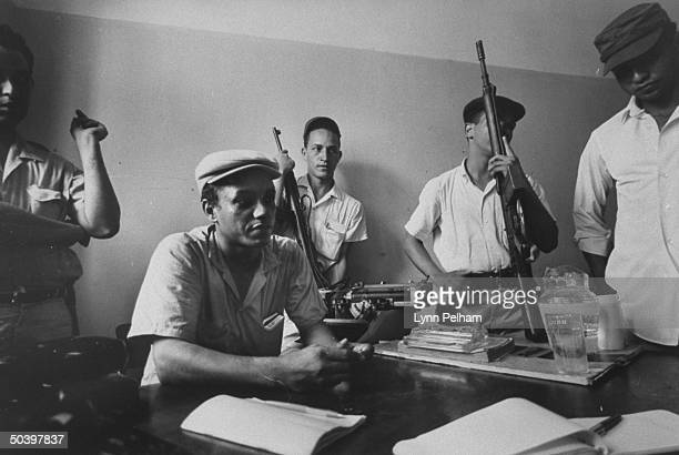 Rebel leader Rafael F Tavaras Rosario and other rebels in their headquarters
