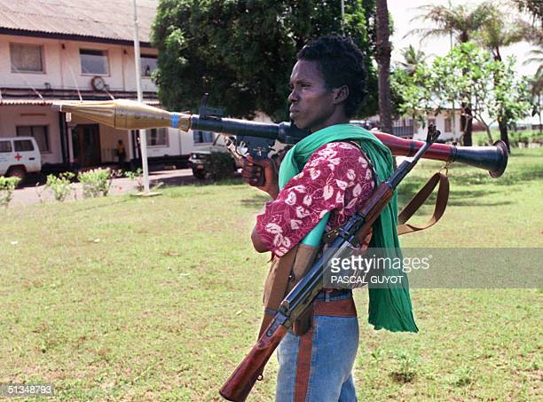 A rebel loyal to warlord Charles Taylor of the National Patriotic Front of Liberia holds automatic riffle and a grenades launcher 30 May 1990 in...
