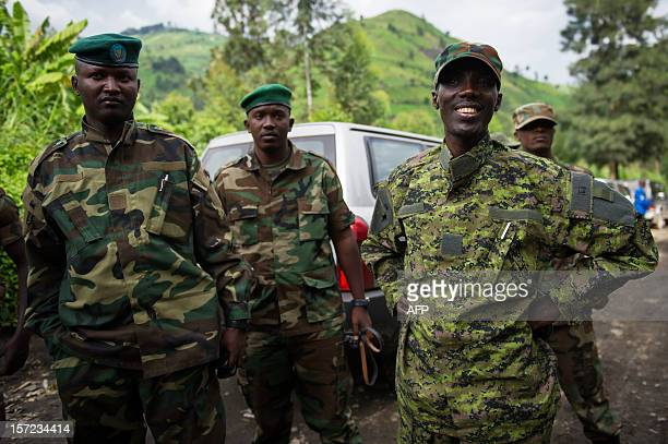 M23 rebel military leader BrigadierGeneral Sultani Makenga addresses officers whilst visiting withdrawing troops near the town of Sake in eastern...