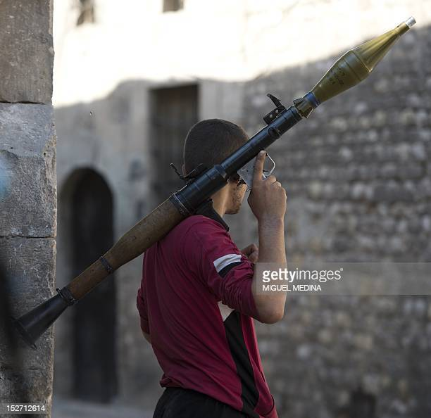 A rebel shoulders a Rocket Propelled Grenade during heavy clashes with Syrian government forces in the neighborhood of Jdeide in the city of Aleppo...