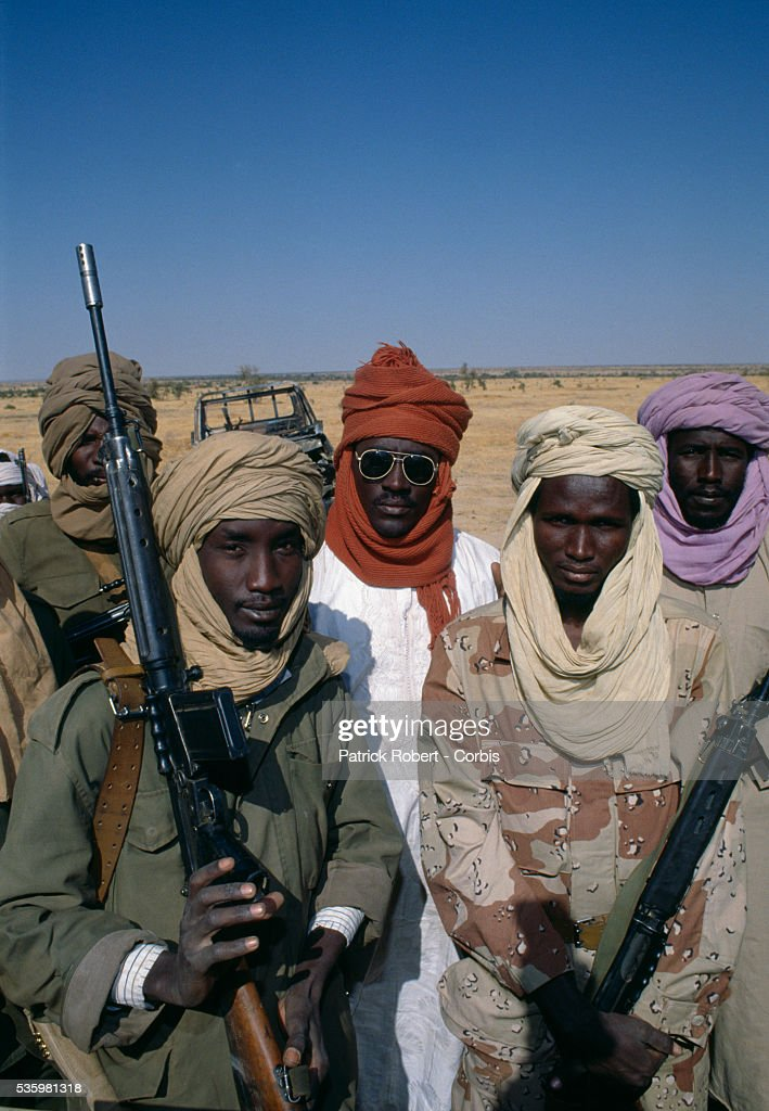 Rebel soldiers with the Forces Armees Nationales Chadiennes (FANT), or National Army of Chad, rest in the Djagaraba oasis near the Sudanese frontier following the fighting between Idriss Deby's partisans and Hissen Habre's troops. Lead by Deby, the Chadian Chief of Staff, the FANT rebellion seized power from head of state Hissen Habre in a French- and Libyan-backed military coup. Deby later won the first multi-party Chadian presidential vote in 1996.