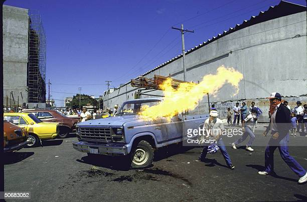 Rebel supporters setting fire to a truck as part of protest during funeral march for slain Human Rights Comm president Herbert Anaya Sanabria