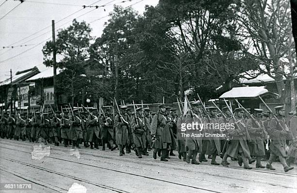 Rebel troops march on to return their barracks after the February 26 Incident on February 29 1936 in Tokyo Japan
