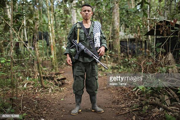 FARC rebel Wilson poses at the 10th Guerrilla Conference in the remote Yari plains where the peace accord was in the process of being ratified by the...