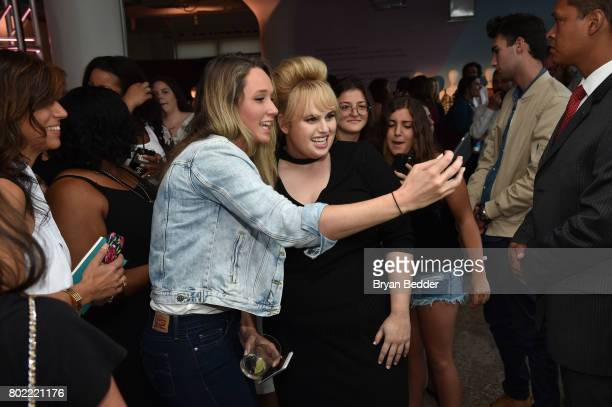 Rebel Wilson poses for a photo with guests at the REBEL WILSON X ANGELS Collection Launch Party at DiaCo on June 27 2017 in New York City