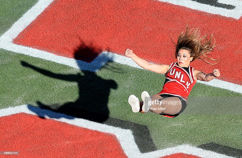 Rebels cheerleader flips in the end zone during the team's game against the San Jose State Spartans at Sam Boyd Stadium on November 2 2013 in Las...
