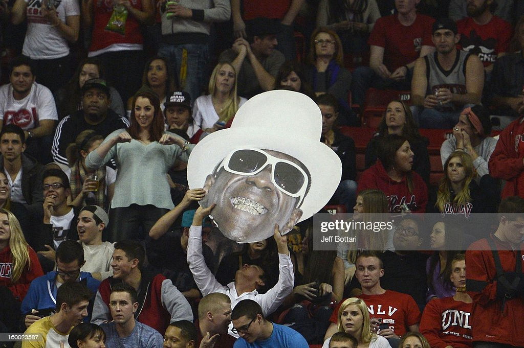 Rebels fans hold up a cutout image of rapper Flavor Flav against the Wyoming Cowboys at the Thomas & Mack Center January 24, 2013 in Las Vegas, Nevada. The Rebels won 62-50.