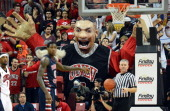 Rebels fans use 'Khem Kong' a large prop of Khem Birch of the UNLV Rebels to try to distract Alex Davis of the Fresno State Bulldogs as he shoots a...