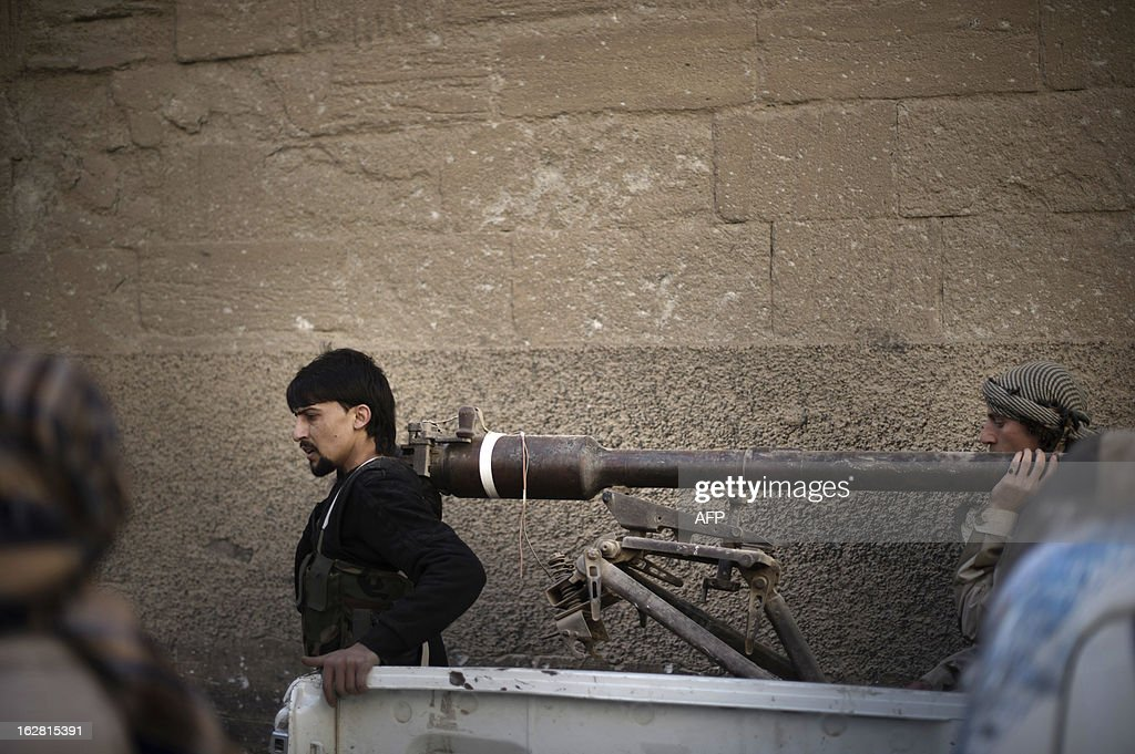 Rebels fighters carry a portable canon during fighting against Syrian government forces on February 27, 2013 in the Hawiqah neighbourhood of the eastern Syrian town of Deir Ezzor. Syria's opposition and foreign powers hold crucial talks in Rome with Washington suggesting it is ready to boost support to rebels in their struggle against President Bashar al-Assad.