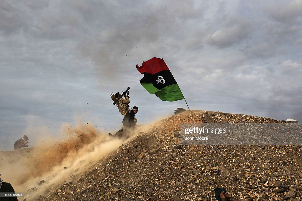 Rebels fire a rocket-propelled grenade at a Libyan air force fighter jet on March 10, 2011 in Ras Lanuf, Libya. Most rebel forces fled the city as government forces loyal to Libyan leader Moammar Gaddafi attacked them with heavy shelling and air strikes.