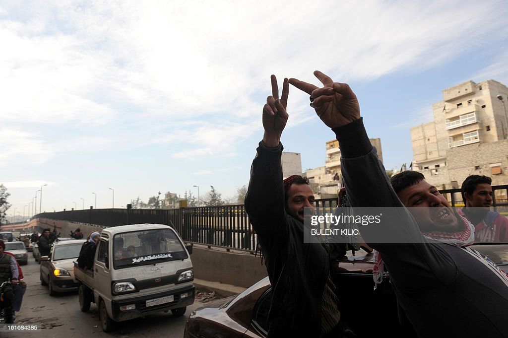 Rebels flash the victory sign as they drive through a street in the northern Syrian city of Aleppo on February 14, 2013. Syrian Foreign Minister Walid al-Muallem and opposition National Coalition chief Ahmed Moaz al-Khatib will make separate visits to Moscow for talks in the coming weeks, a top Russian diplomat said.