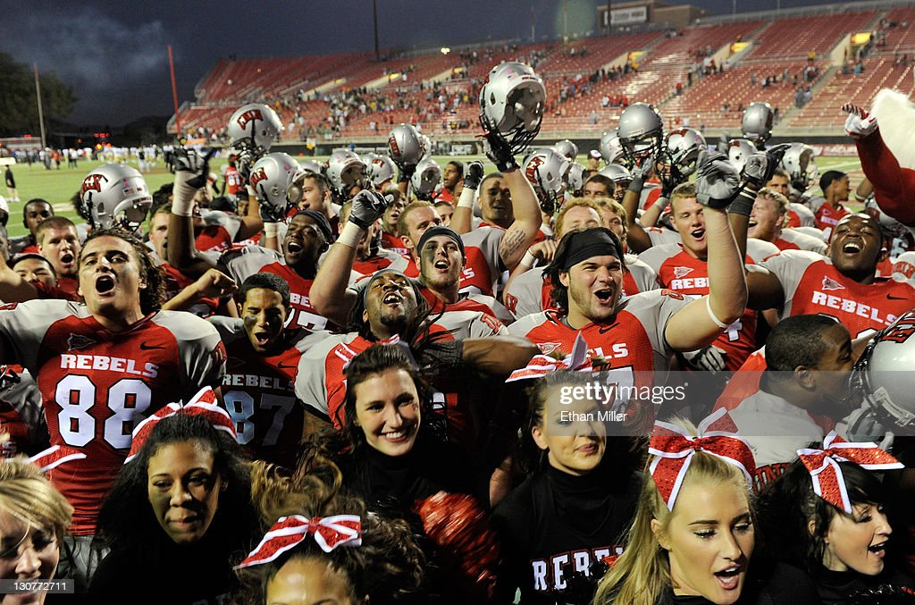 Rebels football players and cheerleaders celebrate the team's 38-35 win over the Colorado State Rams at Sam Boyd Stadium October 29, 2011 in Las Vegas, Nevada.