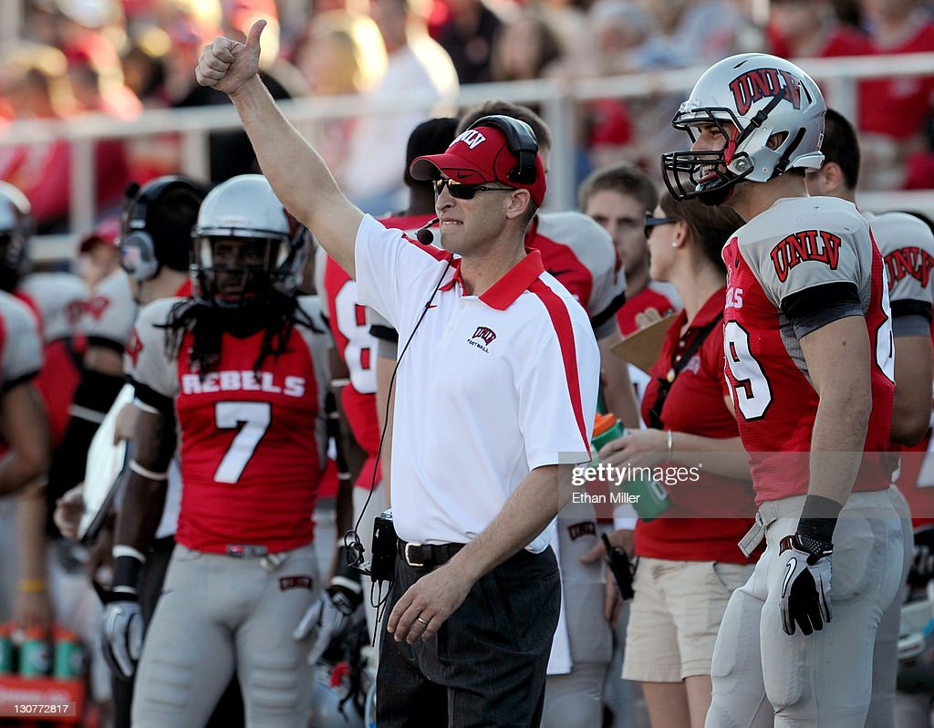 Rebels head football coach Bobby Hauck signals to his team as they take on the Colorado State Rams at Sam Boyd Stadium October 29, 2011 in Las Vegas, Nevada. UNLV won 38-35.